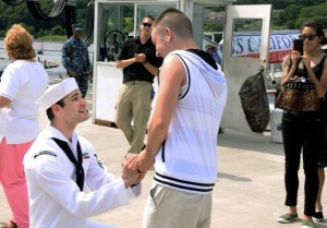 Petty Officer 2nd Class Jerrel Revel, left, proposes to his boyfriend Dylan Kirchner during the homecoming of the USS New Mexico at the submarine base in Groton, Conn., after the ship's inaugural six-month deployment. Photo: U.S. Navy/Kristina Young